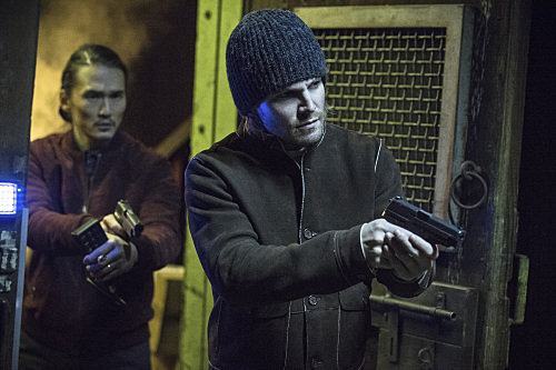 Pictured (L-R): Karl Yune as Maseo and Stephen Amell as Oliver Queen -- Photo: Cate Cameron/The CW