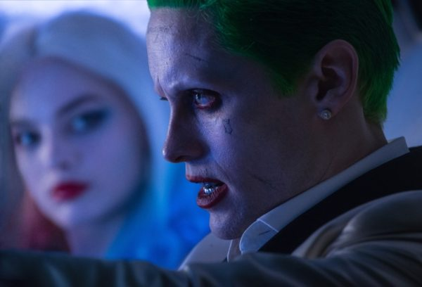 """(L-r) MARGOT ROBBIE as Harley Quinn and JARED LETO as The Joker in Warner Bros. Pictures' action adventure """"SUICIDE SQUAD,"""" a Warner Bros. Pictures release. Copyright: © 2016 WARNER BROS. ENTERTAINMENT INC. AND RATPAC-DUNE ENTERTAINMENT LLC Photo Credit: Clay Enos/ TM & (c) DC Comics"""