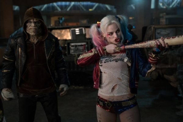 """(L-r) ADEWALE AKINNUOYE-AGBAJE as Killer Croc and MARGOT ROBBIE as Harley Quinn in Warner Bros. Pictures' action adventure """"SUICIDE SQUAD,"""" a Warner Bros. Pictures release. Copyright: © 2016 WARNER BROS. ENTERTAINMENT INC. AND RATPAC-DUNE ENTERTAINMENT LLC Photo Credit: Clay Enos/ TM & (c) DC Comics"""