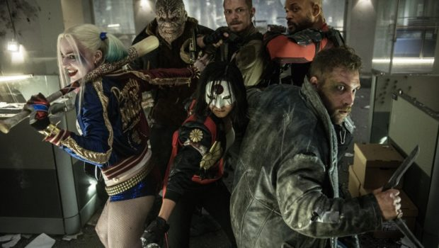"""SS-20727rv3-A Film Name: SUICIDE SQUAD Copyright: © 2016 WARNER BROS. ENTERTAINMENT INC. AND RATPAC-DUNE ENTERTAINMENT LLC Photo Credit: Clay Enos/ TM & (c) DC Comics Caption: (L-r) MARGOT ROBBIE as Harley Quinn, ADEWALE AKINNUOYE-AGBAJE as Killer Croc, KAREN FUKUHARA as Katana, JOEL KINNAMAN as Rick Flagg, JAI COURTNEY as Boomerang and WILL SMITH as Deadshot in Warner Bros. Pictures' action adventure """"SUICIDE SQUAD,"""" a Warner Bros. Pictures release."""