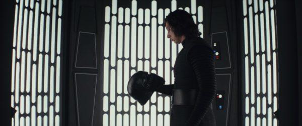 Kylo Ren holds his helmet in Star Wars: The Last Jedi.