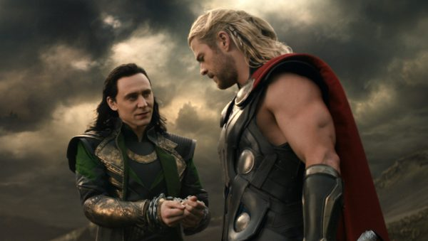 """This publicity photo released by Walt Disney Studios and Marvel shows Tom Hiddleston, left, and Chris Hemsworth in a scene from """"Thor: The Dark World."""" (AP Photo/Walt Disney Studios/Marvel) ORG XMIT: NYET729"""