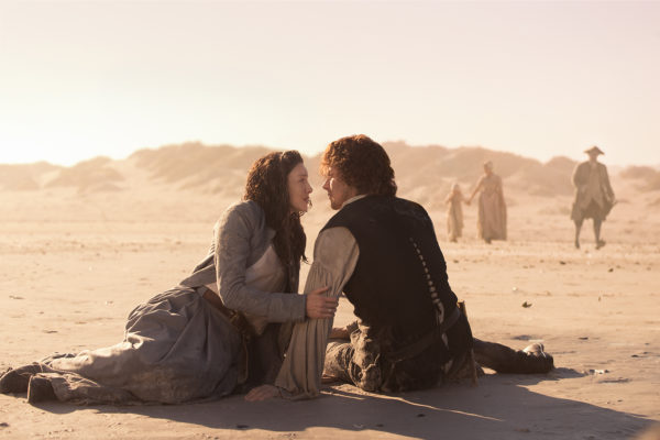 Claire and Jamie on a beach in Outlander A New World.