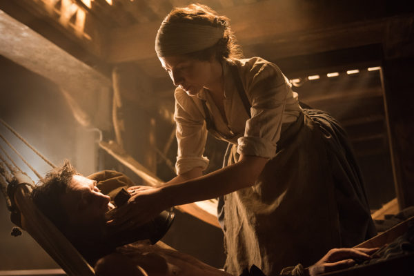 Claire attends a patient in Outlander Heaven and Earth.