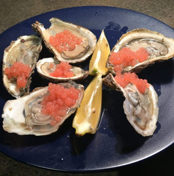 Oysters on the half-shell with guava caviar.