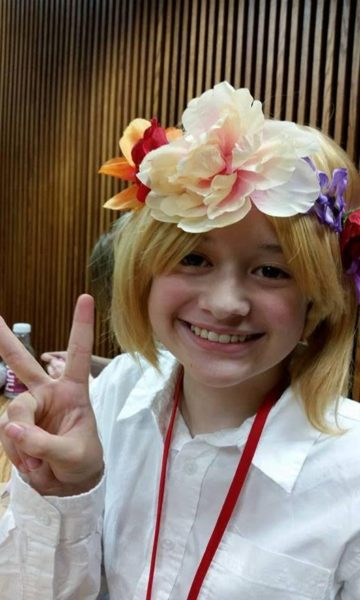 Q as Armin Arlert from 'Attack on Titan Jr. High.' Flower crowns are a fandom meme, just for fun. CR: Amy Peters