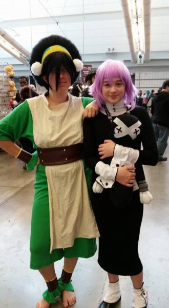 Toph from 'Avatar: The Last Airbender' and Q as Crona from Soul Eater. (Convention attendees are not allowed to be barefoot. Toph is wearing something called 'invisible shoes': soles and a loop over a toe to hold them in place so the top of the foot looks bare. They're common at cons.) CR: Amy Peters